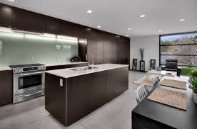 view in gallery in this modern kitchen the glass backsplash