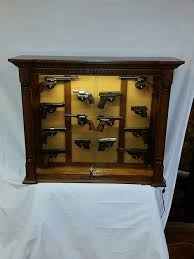 our finished pistol cabinet after glass leather and wall mounted trigger locks have been installed