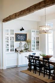 white built in storage display rustic barn wood beam vaulted ceiling floors and farm table dining modern farmhouse ranch interior d1 interior