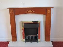 wood fire surround with marble hearth and electric fire
