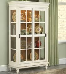 Dining Room China Cabinets Curio Cabinet With Crown Moulding Turned Feet And Sliding Glass