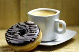 Resultat d'imatges de cafe con rosquillas