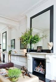 large mirror above fireplace how to live in a small space the best tips mirror above large mirror above fireplace