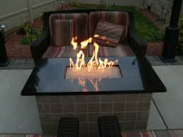 these fire tables pits were accomplished remotely by diy ers all over the country this particular fire table was a wood frame with brick encasing