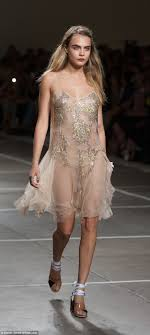 Cara Delevingne leads glamour at Topshop show for London Fashion.