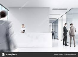 suits office. Two Men In Suits Are Talking A Corner Of An Office Hall. There Is