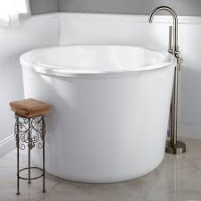 if you are fitting your freestanding tub into a tight space you may want to consider a japanese soaking tub typically this style of tub will be the
