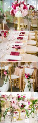 Rose gold tablecloths, gold chargers, berry-red linens, gold vases, flower