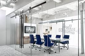 glass conference room with krownlab modern sliding door hardware
