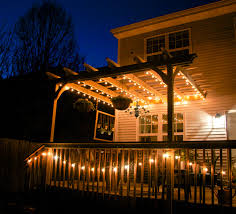 glitter and goat cheese deck and pergola strung with globe lights