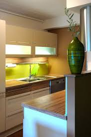 Super Tiny Kitchen That Features A Lot Of Under Cabinet Lights
