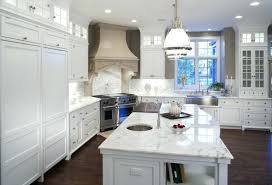 white kitchens with wood floors tile grey floor kitchen surround fireplace mantel dark cabinets natural