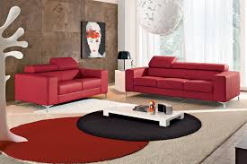 using decorative round red and black living room rug including modern rectangular white low coffee table and red leather living room sofa image