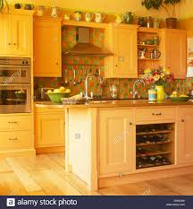 Orange And Yellow Kitchen Green Orange Tiles And Island Unit With Integral Wine Storage In