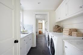 White Laminate Flooring Laundry Room Traditional With White Cabinets Gray  Stone Floor