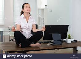 office meditation. Brilliant Office Young Businesswoman Doing Meditation On Desk In Office To N