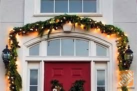 Holiday Door Decorating Ideas For Your Small Porch Lots Of Garland Over The