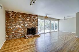 track lighting ceiling. Track Brick Fireplace Refinished Hardwood Floors Lighting Ceiling Fan Over Dining Area On O .