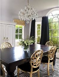 gold dining room table. gold dining chairs with a black room table and white stripe i