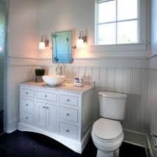 A FarmhouseStyle Bathroom With Lovely Beadboard Wainscoting