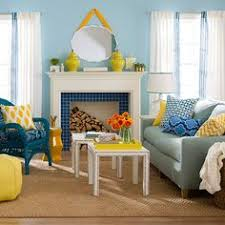 pair together different shades of blue and yellow fun a fun living room more colorful bhg living rooms yellow