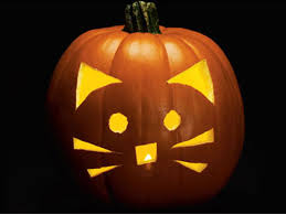 Here's a basic kitty-cat jack-o-lantern. The shapes are simple, and there  aren't too many details for young hands using carving tools for the first  time.