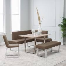 corner dining furniture. this contemporary corner dining set features a high contrast sleekly modern look that pairs white furniture