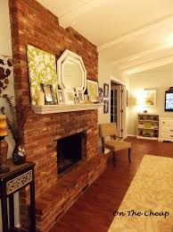 angles red brick fireplace with white mantel