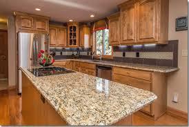 honey oak kitchen cabinets with granite countertops beautiful granite countertops with oak cabinets 09 giallo ornamental