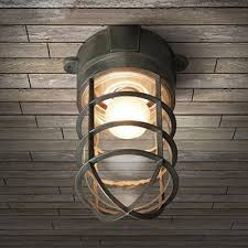 industrial nautical flush mount ceiling fixture with glass shade and metal cage frame in colorful finish