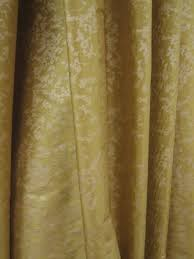 gold shimmery designer fabric with pale gold print