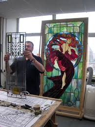 so for him i created four identical leaded stained glass panels with diffe colouring one for each season of the year