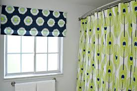 circle patterned bathroom window curtains ideas with stainless steel towel bar and green details shower curtains