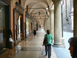 strolling under the porticos more than 12 km long in the city of bologna