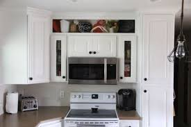 how i built custom open shelves over the cabinets up to the ceiling
