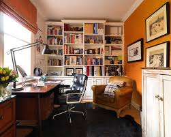 orange home office. this is an example of a small traditional study in london with orange walls no home office