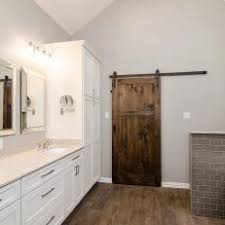 barn door in white bathroom
