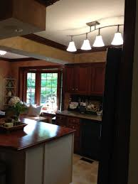 track kitchen lighting. fluorescent kitchen light fixture using ceiling track lighting also glass flower vases and wrought iron book