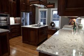 wonderful kitchen decoration with walnut cabinets plus white cambria  countertops plus wooden floor and gas stove