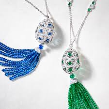 two tassel pendants from the fabergé imperial collection blue sapphire and white diamond pendant with