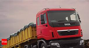 mercial vehicles ashok leyland s tata motors m m tumble up to 14 on new axle load norms times of india