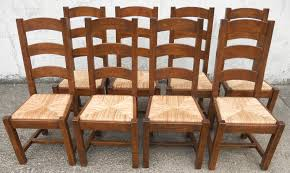 sold set of eight heavy oak ladderback rush seat country style dining chairs