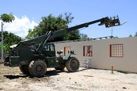 u s department of defense photo essay  u s iers help put up a metal roof frame on a new medical clinic during beyond