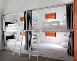 you cant beat bunks for squeezing in the maximum number of beds into a small space add chic curtains for privacy to fit even more overnighters bed in office