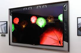 lg tv oled 55. in this photo, you can see the canvas speaker behind faux art mat. lg tv oled 55