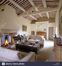 rafters living lighting. Sitting Room With Matching Sofas, Lit Fire And Beamed Ceiling - Stock Image Rafters Living Lighting E