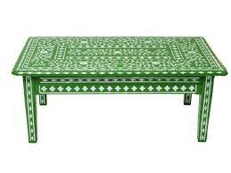 paint a stencil on a coffee table