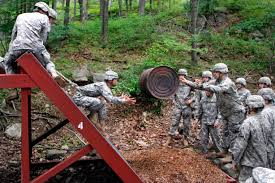 u s department of defense photo essay an army cadet tosses an empty 55 gallon drum to another cadet during the leader