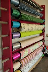 oh and wrapping room every wrapping station needs a wrapping paper holder probably the easiest diy project around and a super cute and a fun way to
