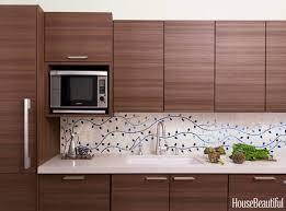 kitchen tile backsplash design. caroline beaupère designed a custom-made tile backsplash to bring new york city kitchen life \u2014 the twisting vines even delicately go around design d